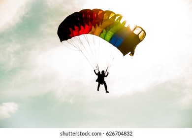 Member of a Parachute Team Descending at a Skydiving Demonstration