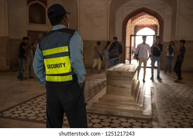 Member of security guard working inside of Humayun's Tomb, New Delhi, India