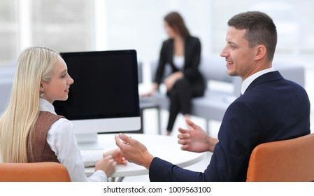 members of a business team discussing a successful business presentation.