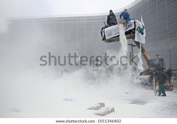 Members of the European Milk Board coat EU Council buildings with milk powder during a protest in Brussels, Belgium on Jan. 23, 2017