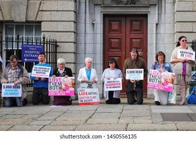 Members of the group 'Our Lady of Lourdes Protectors' hold what they say is a prayer vigil, outside the national maternity hospital in Dublin,Ireland on July 13, 2019.