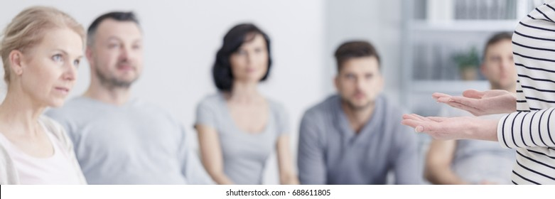 Members of group therapy listening to patient sharing her problems