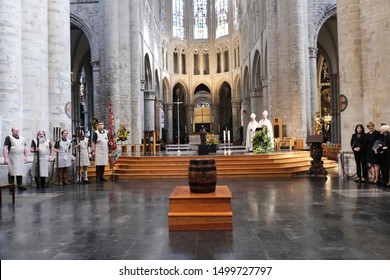 Members of the Knighthood of the Brewer's Paddle attend a mass in front of a barrel of beer during celebrations of Saint-Arnould, patron saint of brewers, at the Saint Gudula Cathedral in Brussels, Be