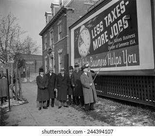Members of the National Chamber of Commerce at their anti-tax billboard. The Chamber was one of several business organizations that opposed New Deal programs. Jan 19, 1939 in Washington D.C. area.