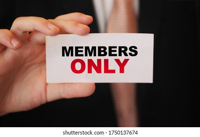 MEMBERS ONLY on a card Businessman holds. VIP clients in business concept.