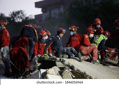 Members of rescue services search for survivors in the debris of a collapsed building in Izmir, Turkey, Monday, Nov. 2, 2020.