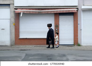 Members of Ultra-Orthodox Jewish community return from the Synagogue after a religion service in Antwerp, Belgium, on Shabbat, July 4, 2020.