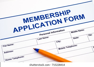 Membership application form with ballpoint pen.