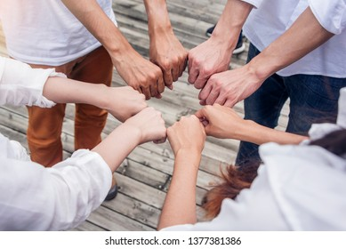 Membership ogetherness Collaboration and success Concept .People putting their hands together show power . Friends with stack of hands showing unity and teamwork