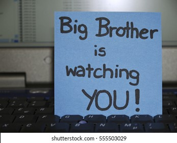 Memo note on notebook, Big brother is watching you
