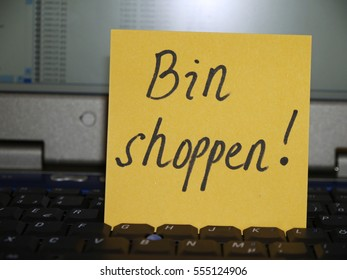 Memo note on notebook, bin shoppen, out for shopping