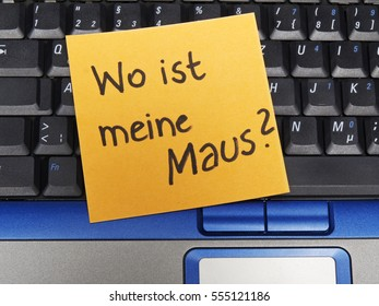 Memo note on notebook, Wo ist meine Maus, where is my mouse