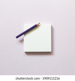Memo paper, sticky notes with colored pencil on purple background. top view, copy space