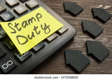 Memo stamp duty land tax on the black calculator.