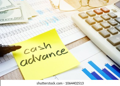 Memo stick about cash advance and calculator.