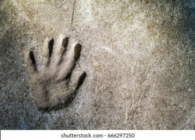 Memorable handprint of a hand in an old concrete wall