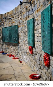 The memorial to the 1982 Falklands War in Port Stanley, emphasizing the plaques with the roll call of the dead. Poppy reefs are visable