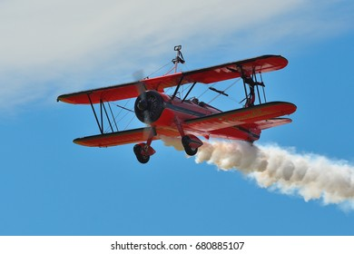Memorial Airshow, 24th of June 2017, Roudnice, Czech Republic. Bucker Jungmeister in flight, smoke effect