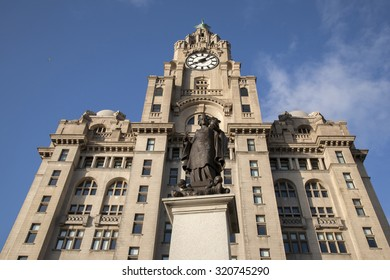 Memorial To Alfred Jones by Frampton (1913) and Royal Liver Building by Thomas (1908), Pier Head; Liverpool; England; UK