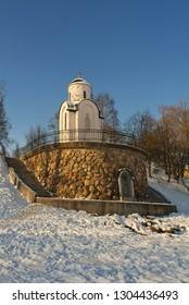 Memorial chapel of St Olga in Pskov, Russia seen across frozen river