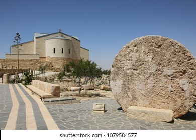 The Memorial church of Moses and Abu badd - rolling stone used as door of Byzantine Monastery on Mount Nebo, Jordan