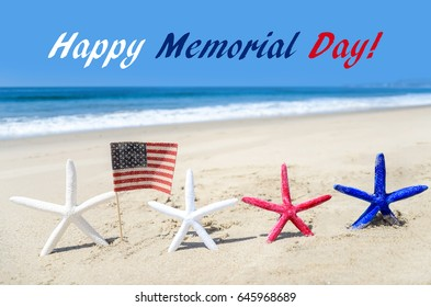 Memorial day background with starfish and decoration on the sandy beach
