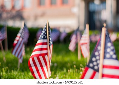 Memorial Day celebration.  Small American flags on a green grass in park.