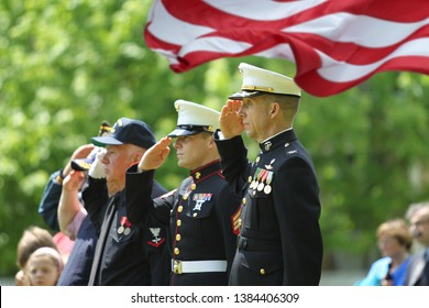 Memorial Day Ceremony hold in Lexington, Massachusetts on May 26,2014. Veteran and Military Officers Saluting at Memorial Day Ceremony