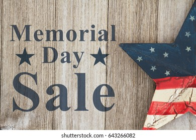 Memorial Day sale message, USA patriotic old star on a weathered wood background with text Memorial Day Sale