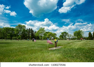 Memorial Day tributes to veterans at a cemetary