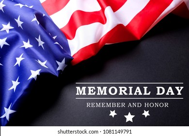Memorial day weekend text written black chalkboard background with USA flag. United States of America stars & stripes patriot veteran remembrance symbol. Close up, copy space, top view.