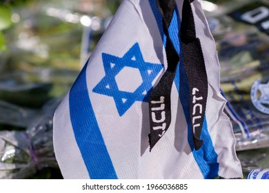 Memorial flag with Yizkor (In memory) word on a soldiers grave on Memorial Day for the Fallen Soldiers of Israel and Victims of Terrorism.