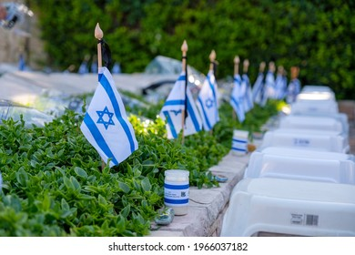 Memorial flags with Yizkor (In memory) word on a soldiers graves on Memorial Day for the Fallen Soldiers of Israel and Victims of Terrorism.