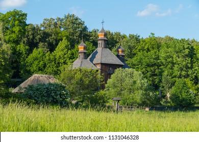Memorial of folk wooden architecture church with domes in the museum. Uzhhorod Ukraine