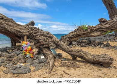 Memorial, hung with colorful artificial flowers at a scenic location near Makena, Maui.
