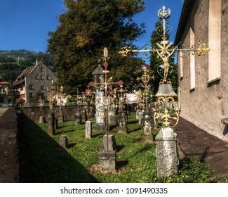 Memorial; ornate metal crosses in Swiss churchyard