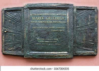 A memorial plaque on the wall of a house in Zamosc, in which Marek Grechuta lived, a Polish poet and a performer of poetry singing. Zamosc, Poland, 19 February 2016