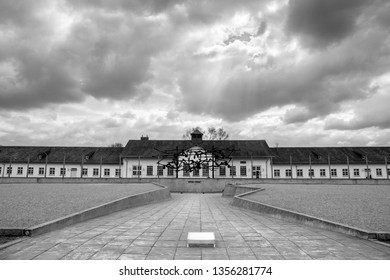Memorial site at former Dachau concentration camp (Konzentrationslager - KZ) under dramatic stormy sky - monochrome (black and white) image. Dachau, Germany - Mar 26. 2019.