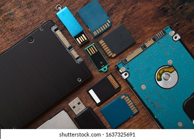 Memory Storage Gadgets. SSD, Hard Disk, SD Cards, Compact Flash and Flashdrive over rustic table.  Data drives.