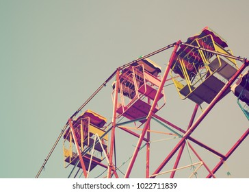 A memory of vintage Ferris wheel in autumn. In Amusement park or festival, Young people like to play Ferris wheel to get a good moment. It is colorful and beautiful vintage style.