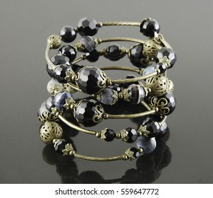 Memory wire agate bracelet on black background