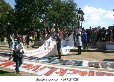 MEMPHIS - AUG 19: Protesters prepare to drape Nathan Bedford Forrest statue in a canvas calling for its removal in the #TakeEmDown901 campaign to dismantle confederate propaganda, August 19, 2017.