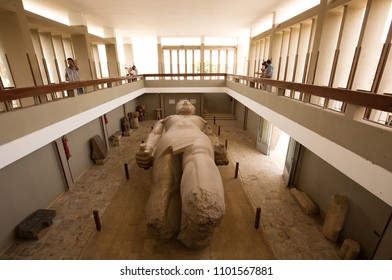 MEMPHIS, EGYPT, APRIL 20: Tourists witness the massive colossus of King Ramses II lying in the open air museum of Memphis, Egypt on April 20, 2018