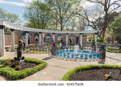 MEMPHIS, TENNESSEE - APRIL 07, 2016: Elvis Presley Grave in Graceland. Tourist and Fountain.