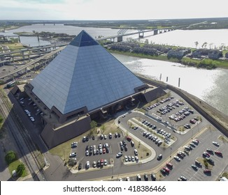 MEMPHIS, TENNESSEE - APRIL 08, 2016: Pyramid in Memphis, Tennessee. Mississippi river in Background with Sunlight. Hernando de Soto Bridge