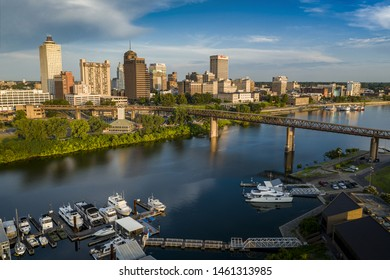 MEMPHIS, TENNESSEE - JULY 7 2019: Panoramic view of the downtown Memphis city skyline, riverside park, the Wolf Creek Harbor, and the Mud Island River Walk and Monorail.