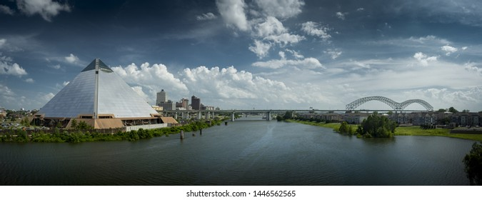MEMPHIS, TENNESSEE - JUNE 28 2019: Panoramic view of the Bass Pro Shops at the Memphis Pyramid, downtown Memphis, the Wolf Creek Harbor, and the Hernando DeSoto Bridge, from the AW Willis Ave bridge.