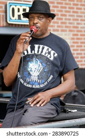 MEMPHIS, TENNESSEE, May 11, 2015 : Blues singer and hamoniscist Vince Johnson plays in the streets of Memphis near Beale Street.