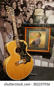 "MEMPHIS, TENNESSEE, May 11, 2015 : Guitars and records from Elvis. Regarded as one of the most significant cultural icons of the 20th century, Elvis Presley is often referred to as ""the King""."