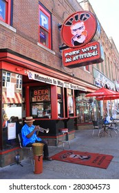 MEMPHIS, TENNESSEE, October 27, 2010: Musician plays for tourists on Beale Street. Blues clubs and restaurants that line Beale Street are major tourist attractions in Memphis.